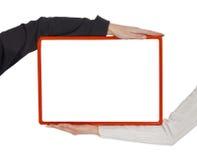 den blanka ramen hands holding två royaltyfri foto