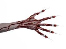 Den blodiga handen med injektionssprutan på fingrarna, tåinjektionssprutor, hand spolar ren, den förfärliga blodiga handen, det h Fotografering för Bildbyråer