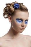 Den blom- makeupen, vänds hon av tre - inkvarterar Arkivfoton
