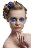 Den blom- makeupen, vänds hon av tre - inkvarterar Royaltyfria Foton