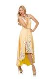 Den blonda flickan i charmig klänning med blomman skrivar ut Royaltyfri Fotografi
