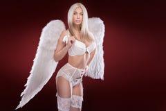 Den blonda kvinnan gillar en ängel Royaltyfria Foton