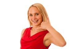 Den blonda kvinnan i röda skjortagester kallar mig isolerad över vit Arkivfoto