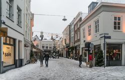 People crossing the snow covered Fonteinstraat in the center of Den Bosch. Royalty Free Stock Images
