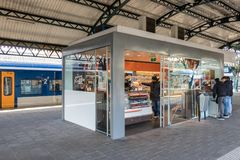 Customers buying sweets at kiosk in Den Bosch train station Stock Photography