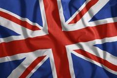 Den brittiska flaggan är flyget i vinden Färgrikt nationsflagga av Storbritannien patriotism vektor illustrationer