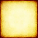 den brända bakgrunden edges guld- Royaltyfria Bilder