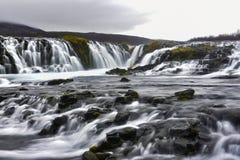 Den Bruarfoss bronedgången, är en vattenfall på floden Bruara, in Royaltyfria Foton