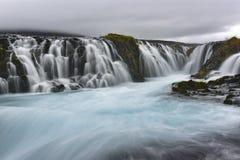 Den Bruarfoss bronedgången, är en vattenfall på floden Bruara, in Royaltyfria Bilder