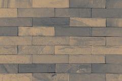 Den bruna färgtegelstentexturen Arkivfoton