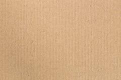 Den bruna pappers- asken är tom abstrakt pappbakgrund Arkivbild