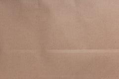 Den bruna skrynklan återanvänder pappers- bakgrund, Eco pappers- bakgrund Arkivfoton