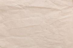 Den bruna skrynklan återanvänder pappers- bakgrund, Eco pappers- bakgrund Royaltyfri Foto