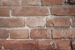Den bruna tegelstenväggen texturerar arkivbilder