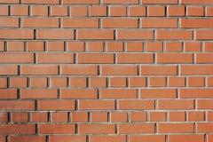 Den bruna tegelstenväggen texturerar Arkivfoton