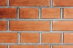 Den bruna tegelstenväggen texturerar arkivfoto