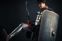 Den brutala krigaren av Sparta slår footed Arkivfoton