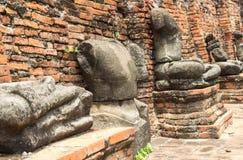Den buddha bilden förstörs i krig Arkivfoton
