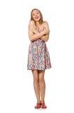 Den caucasian flickan för blondie i sommarljusklänningen som isoleras på vit Royaltyfri Foto