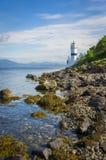 Den Cloch fyren på kusten av Cloch punkt - Inverclyde i Skottland Arkivfoton