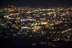Den Defocused abstrakta ChiangMai stadsnatten tänder bakgrund Fotografering för Bildbyråer