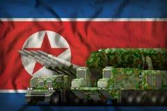 Den Demokratiska Folkrepubliken Korea Nordkorea raket gå i skaror begrepp på nationsflaggabakgrunden illustration 3d Fotografering för Bildbyråer