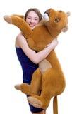 den djura flickan rymmer toyen Royaltyfria Foton