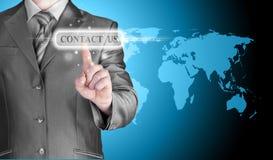 Den driftiga affärsmanhanden kontaktar oss knappen Fotografering för Bildbyråer