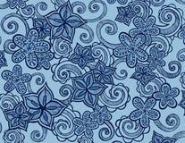 Den drog handen blommar på blå bakgrund med krullning och virvlar runt Royaltyfria Foton