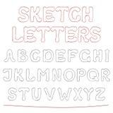 Den drog handen skissar alfabet Arkivbild