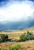 Den dubbla regnbågen börjar Royaltyfri Bild