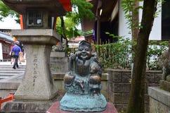 Den Ebisu statyguden av fishers eller köpmän är de sju gudarna av Fo Arkivfoton