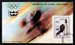 Den Ekvatorialguinea portostämpeln visar jätte- slalom, olympiska spel i Innsbruck, circa 1976 Arkivbilder