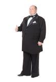 Den eleganta feta manen i en smoking visar tumen-upp Fotografering för Bildbyråer