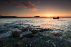 Den ensamma solnedgången Arkivfoto
