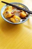Den etniska kinesiska maträtten, den välfyllda beancurden flår Arkivbild