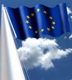 Den europeiska flaggan, också som är bekant som den europeiska flaggan, består av tolv guld- stjärnor som är ordnade i en cirkel  Arkivfoto