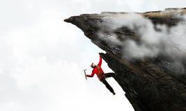 Den extrema klättringen är hans adrenalin Blandat massmedia Arkivfoton