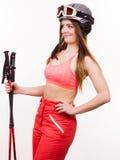 Den färdiga flickan med skidar poler Royaltyfri Fotografi