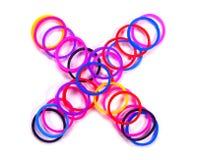 Den färgrika gummibandet multiplicerar symbol Royaltyfri Foto