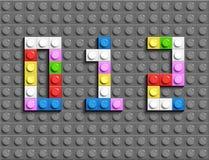 Den färgrika legoen numrerar 7,8,9 från plast- byggnadslegotegelstenar Färgrika vektorlegonummer Grå legobakgrund Royaltyfri Fotografi