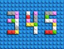 Den färgrika legoen numrerar 3,4,5 från plast- byggnadslegotegelstenar Färgrika vektorlegonummer Svart legobakgrund Royaltyfri Fotografi