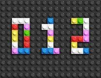 Den färgrika legoen numrerar 0,1,2 från plast- byggnadslegotegelstenar Färgrika vektorlegonummer Svart legobakgrund Arkivbild