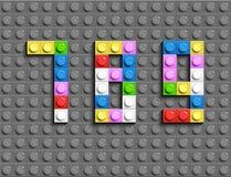 Den färgrika legoen numrerar 7,8,9from plast- byggnadslegotegelstenar Färgrika vektorlegonummer Grå legobakgrund Fotografering för Bildbyråer