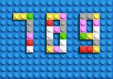 Den färgrika legoen numrerar 7,8,9from plast- byggnadslegotegelstenar Färgrika vektorlegonummer Svart legobakgrund Royaltyfria Foton