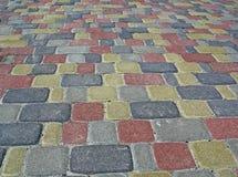 den färgrika mångfaldstapeln stenar gatan Royaltyfri Fotografi
