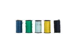 Den färgrika Minin tråden i isolerad stil Royaltyfri Foto
