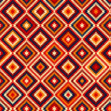 Den färgrika röda gulingblåttaztecen smyckar den geometriska etniska sömlösa modellen, vektor Royaltyfria Bilder
