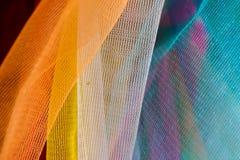 Den färgrika thailändska plast- girlanden, kan finnas på några buddistiska vikarier Arkivfoton