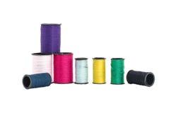 Den färgrika tråden i isolerad stil Fotografering för Bildbyråer